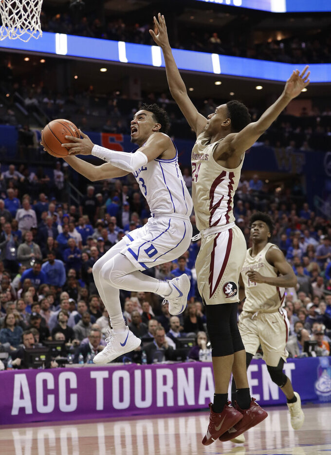 Duke's Tre Jones (3) drives past Florida State's Devin Vassell (24) during the second half of the NCAA college basketball championship game of the Atlantic Coast Conference tournament in Charlotte, N.C., Saturday, March 16, 2019. (AP Photo/Nell Redmond)