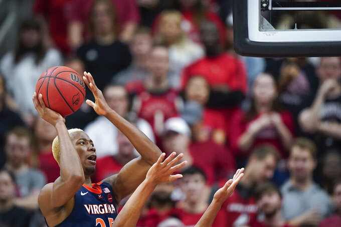 Virginia forward Mamadi Diakite (25) shoots the ball during the second half of an NCAA college basketball game against Louisville, Saturday, Feb 8, 2020 in Louisville, Ky. (AP Photo/Bryan Woolston)