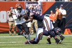 Cincinnati Bengals wide receiver Ja'Marr Chase, left, is unable to catch quarterback Joe Burrow's pass as Chicago Bears defensive back DeAndre Houston-Carson (36) and Kindle Vildor (22) defend during the first half of an NFL football game Sunday, Sept. 19, 2021, in Chicago. (AP Photo/David Banks)