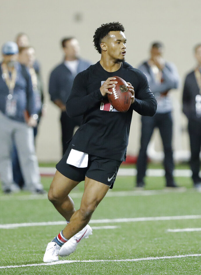 Oklahoma quarterback Kyler Murray goes through passing drills at the university's Pro Day for NFL scouts in Norman, Okla., Wednesday, March 13, 2019. (AP Photo/Alonzo Adams)