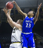 Hampton's Kalin Fisher (23) blocks the shot of Notre Dame's Martinas Geben (23) during an NCAA college basketball game in the first round of the NIT tournament, Tuesday, March 13, 2018, in South Bend, Ind. (Michael Caterina/South Bend Tribune via AP)