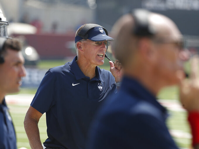 Connecticut coach Randy Edsall watches his team against Fresno State during the second half of an NCAA college football game in Fresno, Calif., Saturday, Aug. 28, 2021. (AP Photo/Gary Kazanjian)