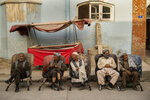 Laborers wait in the street to be hired in Kabul, Afghanistan, Sunday, Sept. 12, 2021. (AP Photo/Bernat Armangue)