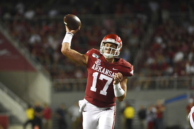 Arkansas quarterback Nick Starkel throws a pass that was intercepted bySan Jose State during the second half of an NCAA college football game Saturday, Sept. 21, 2019, in Fayetteville, Ark. (AP Photo/Michael Woods)