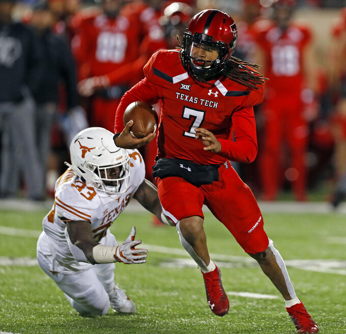 Texas Tech's Jett Duffey (7) breaks away from Texas' Gary Johnson (33) during the second half of an NCAA college football game Saturday, Nov. 10, 2018, in Lubbock, Texas. (AP Photo/Brad Tollefson)