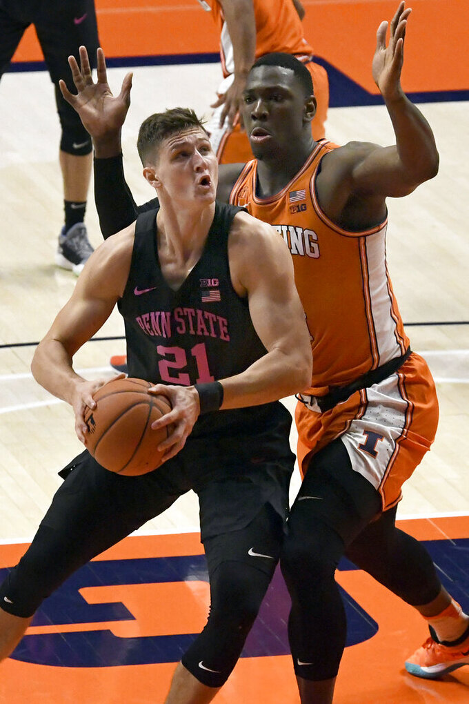 Penn State forward John Harrar (21) looks to shoot as he is pressured by Illinois center Kofi Cockburn during the first half of an NCAA college basketball game Tuesday, Jan. 19, 2021, in Champaign, Ill. (AP Photo/Holly Hart)
