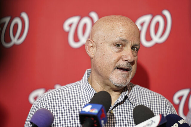 FILE - In this Jan. 11, 2020, file photo, Washington Nationals general manager Mike Rizzo talks with members of the media during the team's