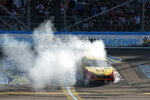Joey Logano does a burnout across the start/finish line after winning a NASCAR Cup Series auto race at Phoenix Raceway, Sunday, March 8, 2020, in Avondale, Ariz. (AP Photo/Ralph Freso)