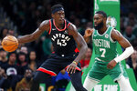 Toronto Raptors' Pascal Siakam (43) looks to move on Boston Celtics' Jaylen Brown (7) during the first half of an NBA basketball game in Boston, Friday, Oct. 25, 2019. (AP Photo/Michael Dwyer)