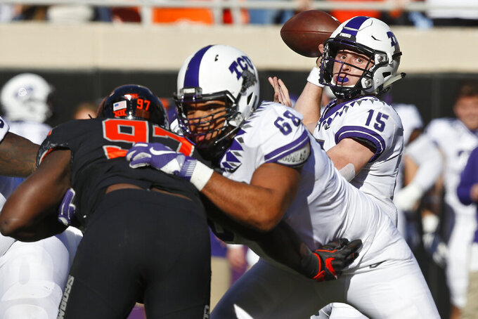 TCU quarterback Max Duggan (15) passes as offensive tackle Anthony McKinney (68) blocks Oklahoma State defensive tackle Amadou Fofana (97) in the first half of an NCAA college football game in Stillwater, Okla., Saturday, Nov. 2, 2019. (AP Photo/Sue Ogrocki)
