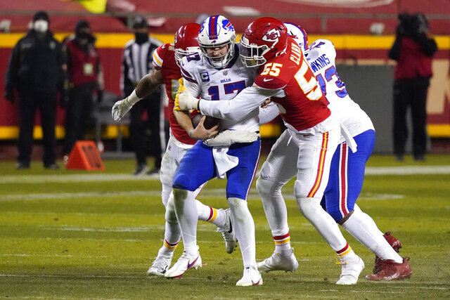 Buffalo Bills quarterback Josh Allen (17) is sacked by Kansas City Chiefs defensive end Frank Clark (55) during the second half of the AFC championship NFL football game, Sunday, Jan. 24, 2021, in Kansas City, Mo. (AP Photo/Jeff Roberson)