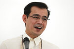 """FILE - In this June 7, 2021, file photo, Manila City Mayor Francisco """"Isko Moreno"""" Domagoso speaks during the inauguration of the Manila Islamic Cemetery and Cultural Hall in Manila, Philippines. The popular mayor of the Philippine capital said he would run for president in next year's elections, the latest aspirant in what is expected to be a crowded race to succeed controversial leader Rodrigo Duterte. (AP Photo/Aaron Favila, File)"""