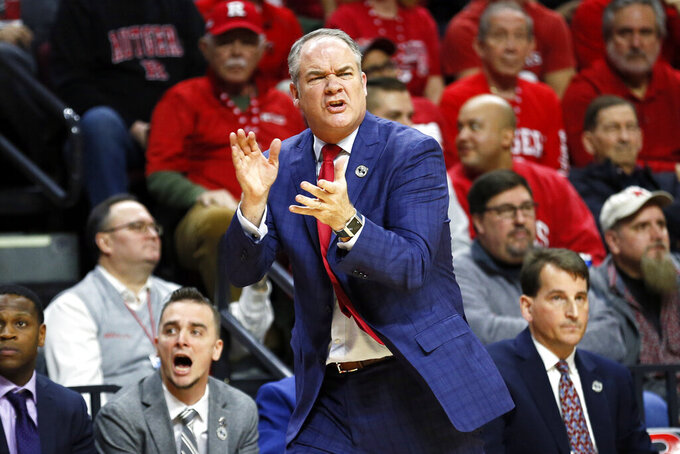 FILE - Rutgers head coach Steve Pikiell directs his team against Illinois during the first half of an NCAA college basketball game in Piscataway, N.J., in this Saturday, Feb. 15, 2020, file photo. Rutgers won 72-57.  Rutgers is heading into the basketball season with its first preseason ranking since 1978-79. (AP Photo/Adam Hunger, File)