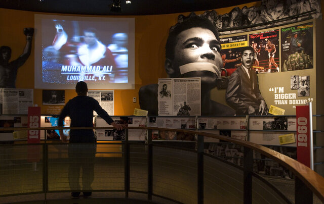 FILE - In this Wednesday, Jan. 11, 2012, file photo, Ben Physick, of Australia, watches the life of Muhammad Ali in video clips on display at the Muhammad Ali Center in Louisville, Ky. Two sites in Kentucky and two in Tennessee have been added to the U.S. Civil Rights Trail, including the Muhammad Ali Center, officials said Thursday, Feb. 13, 2020. (AP Photo/Brian Bohannon, File)