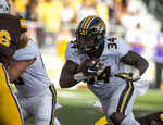 Missouri running back Larry Roundtree runs for a touchdown against Wyoming in the first quarter of an NCAA college football game Saturday, Aug. 31, 2019, in Laramie, Wy. (AP Photo/Michael Smith)