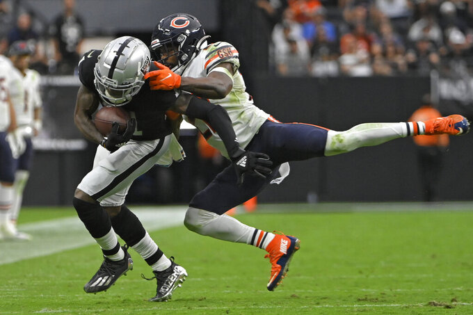 Las Vegas Raiders wide receiver Henry Ruggs III (11) makes a reception against Chicago Bears cornerback Kindle Vildor (22) during the second half of an NFL football game, Sunday, Oct. 10, 2021, in Las Vegas. (AP Photo/David Becker)