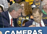 This ABC TV frame grab image from Friday May 24, 2019, shows New York Mayor Bill de Blasio, left, offering a drink to Congressman Jerrold Nadler, right, after he fell ill during a press conference in New York. Nadler, 71, the chairman of the House Judiciary committee had given remarks at an event about speed enforcement cameras in school zones, and someone else was speaking when he slumped in his chair. (ABC-TV via AP)