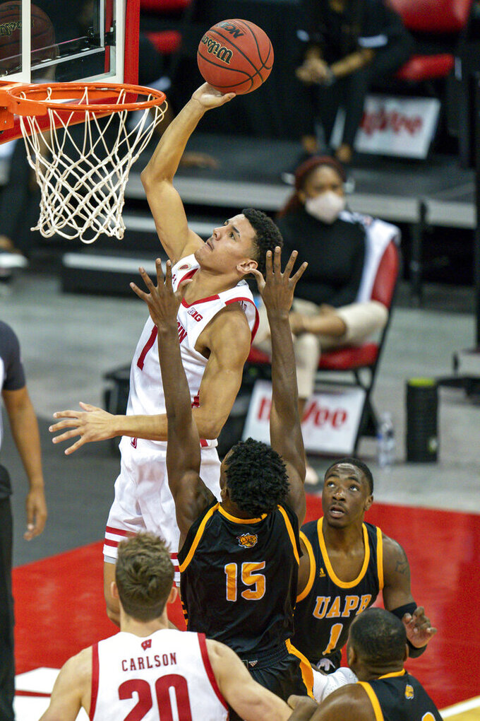 Wisconsin's Jonathan Davis (1) shoots against Arkansas-Pine Bluff's Alvin Stredic (15) and Jalen Lynn (1) during the first half of an NCAA college basketball game Friday, Nov. 27, 2020, in Madison, Wis. (AP Photo/Andy Manis)