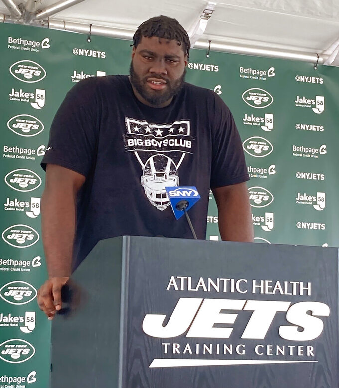New York Jets left tackle Mekhi Becton speaks to reporters at the team's NFL football training camp facility in Florham Park, N.J., Tuesday July 27, 2021. (AP Photo/Dennis Waszak Jr.)