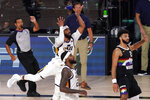 Utah Jazz's Mike Conley, middle center, Royce O'Neale, bottom center, Jazz head coach Quin Snyder, center rear, and Denver Nuggets' Jamal Murray, right, watch as Conley's shot rims out in the closing seconds of their NBA first round playoff basketball game, Tuesday, Sept. 1,2020, in Lake Buena Vista, Fla. (AP Photo/Mark J. Terrill)