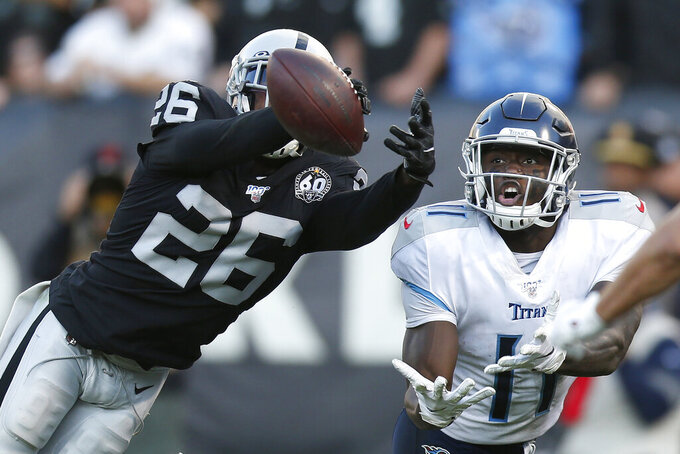Oakland Raiders cornerback Nevin Lawson (26) breaks up a pass intended fo Tennessee Titans wide receiver A.J. Brown (11) during the second half of an NFL football game in Oakland, Calif., Sunday, Dec. 8, 2019. (AP Photo/D. Ross Cameron)