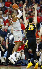 Ohio State forward Kaleb Wesson, left, goes up for a shot against Iowa forward Ryan Kriener during the first half of an NCAA college basketball game in Columbus, Ohio, Tuesday, Feb. 26, 2019. (AP Photo/Paul Vernon)
