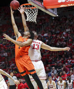 Oregon State guard Stephen Thompson Jr. (1) lays the ball up to the basket while being guarded by Utah forward Novak Topalovic (13) during the first half of an NCAA college basketball game, Saturday, Feb. 2, 2019, in Salt Lake City. (AP Photo/Chris Nicoll)