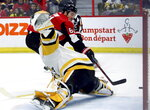 Ottawa Senators right wing Mark Stone (61) scores against Pittsburgh Penguins goaltender Casey DeSmith (1) during second-period NHL hockey game action in Ottawa, Ontario, Saturday, Nov. 17, 2018. (Fred Chartrand/The Canadian Press via AP)