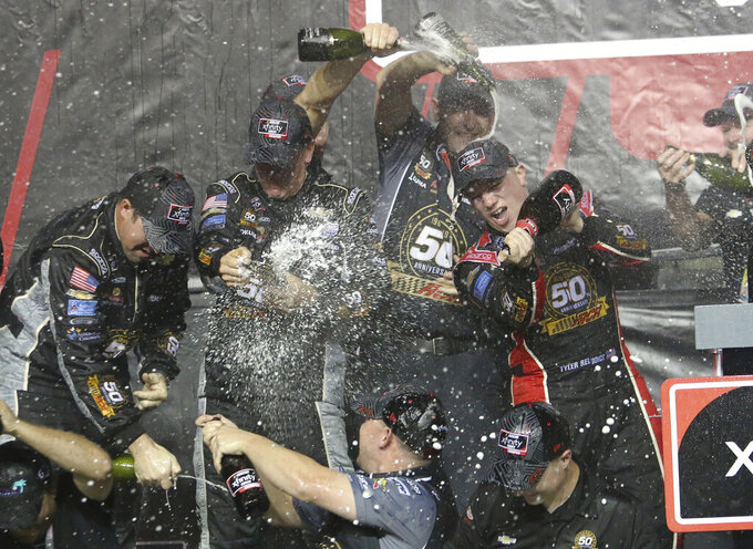 Tyler Reddick, right, celebrates in Victory Lane after winning the NASCAR Xfinity Series auto racing championship on Saturday, Nov. 16, 2019, at Homestead-Miami Speedway in Homestead, Fla. (AP Photo/David Graham)