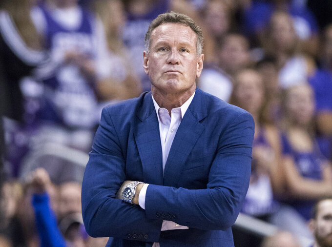 FILE - In this Dec. 9. 2018, file photo, Grand Canyon coach Dan Majerle watches his team play Nevada during the first half of an NCAA college basketball game in Phoenix. Grand Canyon has fired Majerle after seven seasons. The school announced the former Phoenix Suns star's firing Thursday, March 12, 2020, hours after the Western Athletic Conference and NCAA tournament were canceled due to concerns over the coronavirus. (AP Photo/Darryl Webb, File)
