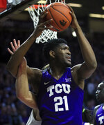 TCU center Kevin Samuel (21) is fouled by Kansas State forward Dean Wade, back, during the first half of an NCAA college basketball game in Manhattan, Kan., Saturday, Jan. 19, 2019. (AP Photo/Orlin Wagner)