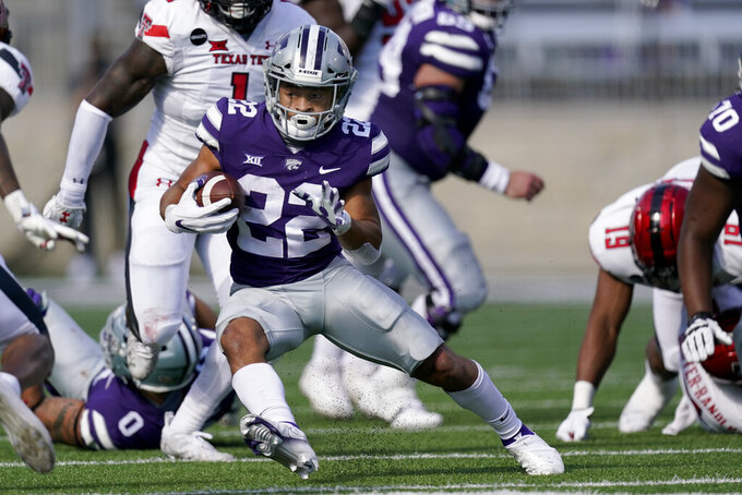FILE - In this Oct. 3, 2020, file photo, Kansas State running back Deuce Vaughn runs for a first down during the first half of the team's NCAA college football game against Texas Tech in Manhattan, Kan. Vaughn is the only Big 12 player to lead his team in rushing and receiving, and is one of only two players nationally with at least 300 yards rushing and 300 yards receiving. (AP Photo/Charlie Riedel, File)