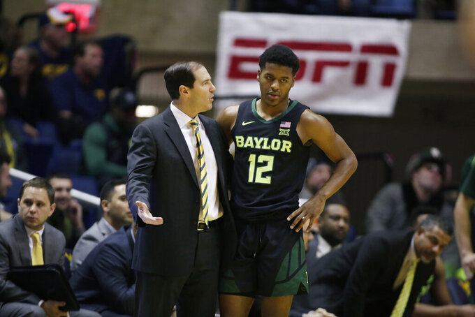 Baylor head coach Scott Drew talks with Baylor guard Jared Butler (12) during the first half of an NCAA college basketball game against West Virginia Monday, Jan. 21, 2019, in Morgantown, W.Va. (AP Photo/Raymond Thompson)