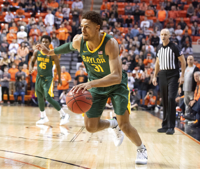 Baylor guard MaCio Teague (31) drives the ball during the second half of an NCAA college basketball game against Oklahoma State in Stillwater, Okla., Saturday, Jan. 18, 2020. (AP Photo/Brody Schmidt)