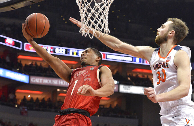 Louisville guard Christen Cunningham (1) tempts a layup past the defense of Virginia forward Jay Huff (30) during the second half of an NCAA college basketball game in Louisville, Ky., Saturday, Feb. 23, 2019. Virginia won 64-52. (AP Photo/Timothy D. Easley)