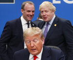 FILE - In this Wednesday, Dec. 4, 2019 file photo U.S. President Donald Trump, center, seated, British Prime Minister Boris Johnson, rear right, and British Foreign Secretary Dominic Raab, rear left, attend a NATO round table meeting at The Grove hotel and resort in Watford, Hertfordshire, England. (AP Photo/Frank Augstein, File)