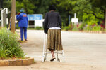 In this Jan. 10, 2019, photo, a woman makes her way to Parirenyawatwa Hospital in Harare, Zimbabwe. A doctors strike in Zimbabwe has crippled a health system that was already in intensive care from neglect. It mirrors the state of affairs in a country that was full of promise a year ago with the departure of longtime leader Robert Mugabe but now faces economic collapse.(AP Photo/Tsvangirayi Mukwazhi)
