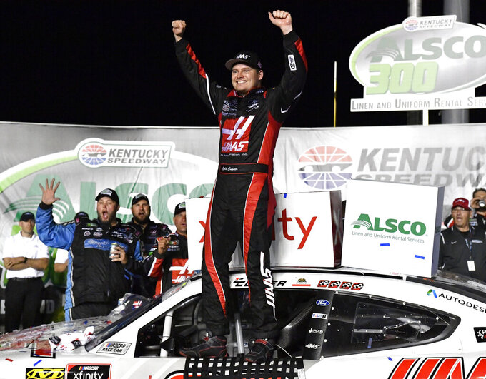 Cole Custer raises his hands in victory following the NASCAR Xfinity Series auto race at Kentucky Speedway in Sparta, Ky., Friday, July 12, 2019. (AP Photo/Timothy D. Easley)