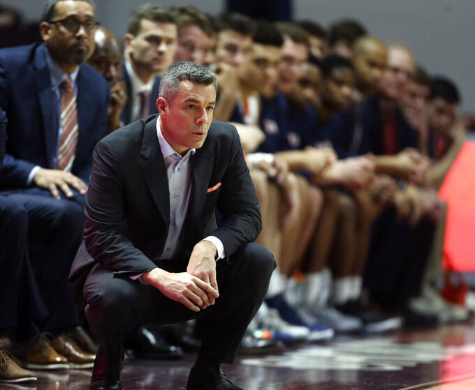 Virginia coach Tony Bennett watches during the first half of the team's NCAA college basketball game against Virginia Tech on Wednesday, Feb. 26, 2020, in Blacksburg, Va. (Matt Gentry/The Roanoke Times via AP)