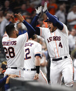 Houston Astros' George Springer (4) celebrates his solo home run off Oakland Athletics starting pitcher Brett Anderson with Robinson Chirinos during the third inning of a baseball game, Wednesday, Sept. 11, 2019, in Houston. (AP Photo/Eric Christian Smith)