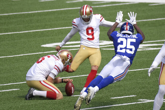 San Francisco 49ers' Robbie Gould, center, kicks a field goal while New York Giants' Corey Ballentine tries to defend during the first half of an NFL football game, Sunday, Sept. 27, 2020, in East Rutherford, N.J. (AP Photo/Bill Kostroun)