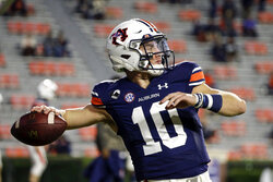 Auburn quarterback Bo Nix warms up for the team's NCAA college football game against Tennessee on Saturday, Nov. 21, 2020, in Auburn, Ala. (AP Photo/Butch Dill)