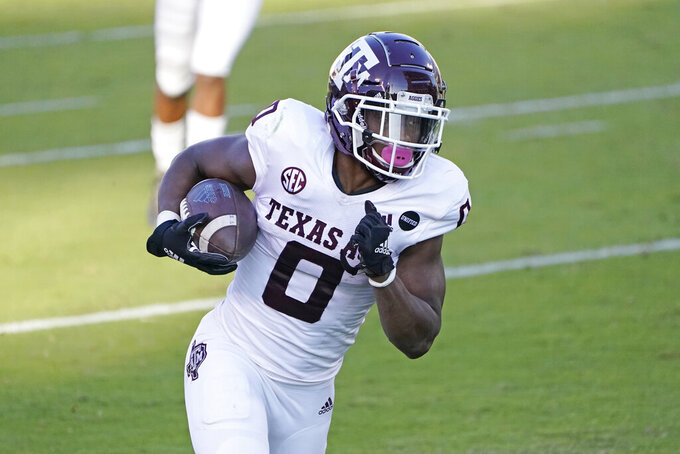 Texas A&M running back Ainias Smith (0) runs with a six-yard touchdown reception against Mississippi State during the second half of an NCAA college football game in Starkville, Miss., Saturday, Oct. 17, 2020. (AP Photo/Rogelio V. Solis)