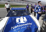 Alex Bowman, right, stands by his car on pit road after he won the pole position during qualifying for the NASCAR Daytona 500 auto race at Daytona International Speedway, Sunday, Feb. 11, 2018, in Daytona Beach, Fla. (AP Photo/John Raoux)