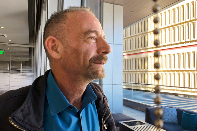 "FILE - This March 4, 2019 file photo shows Timothy Ray Brown in Seattle. Brown, who made history as ""the Berlin patient,"" the first person known to be cured of HIV infection, died Tuesday, Sept. 29, 2020, at his home in Palm Springs, Calif., according to a social media post by his partner, Tim Hoeffgen. He was 54. The cause was a return of the cancer that originally prompted the unusual bone marrow and stem cell transplants Brown received in 2007 and 2008, which for years seemed to have eliminated both his leukemia and HIV, the virus that causes AIDS. (AP Photo/Manuel Valdes, File)"