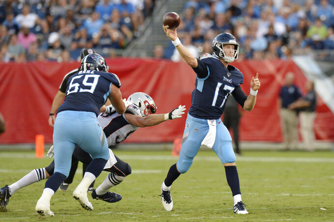 Tennessee Titans quarterback Ryan Tannehill (17) passes against the New England Patriots in the first half of a preseason NFL football game Saturday, Aug. 17, 2019, in Nashville, Tenn. (AP Photo/Mark Zaleski)
