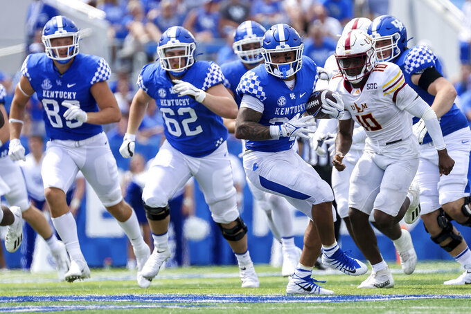Kentucky running back Chris Rodriguez Jr. (24) runs the ball up the field during the second half of an NCAA college football game against Louisiana-Monroe in Lexington, Ky., Saturday, Sept. 4, 2021. (AP Photo/Michael Clubb)