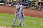New York Mets' Robinson Cano, right, is helped off the field by first base coach Glenn Sherlock during the fourth inning of a baseball game against the Pittsburgh Pirates in Pittsburgh, Sunday, Aug. 4, 2019. (AP Photo/Gene J. Puskar)