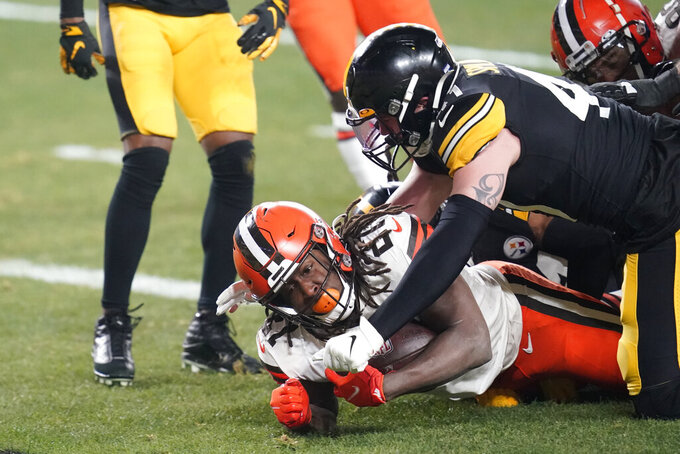 Cleveland Browns running back Kareem Hunt (27) scores on an 11-yard run with Pittsburgh Steelers inside linebacker Robert Spillane (41) defending during the first half of an NFL wild-card playoff football game, Sunday, Jan. 10, 2021, in Pittsburgh. (AP Photo/Keith Srakocic)