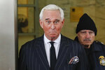 """FILE - In this Feb. 1, 2019 file photo, former campaign adviser for President Donald Trump, Roger Stone, leaves federal court in Washington. The Justice Department said Tuesday it will take the extraordinary step of lowering the amount of prison time it will seek for Roger Stone, an announcement that came just hours after President Donald Trump complained that the recommended sentence for his longtime ally and confidant was """"very horrible and unfair."""